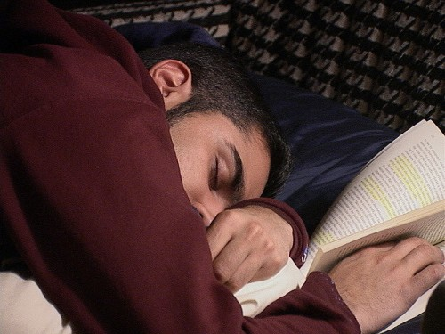 Asleep with book in hand